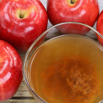 Image of bowl of apple cider and 3 apples