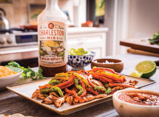 Image of chicken fajitas with a bottle of Charleston mix