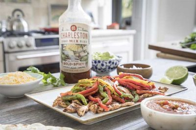 chicken fajitas in the kitchen with bottle of Charleston Mix