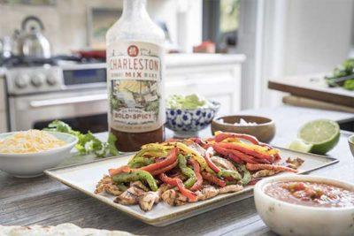 chicken fajitas in the kitchen with bottle of Charleston Mix