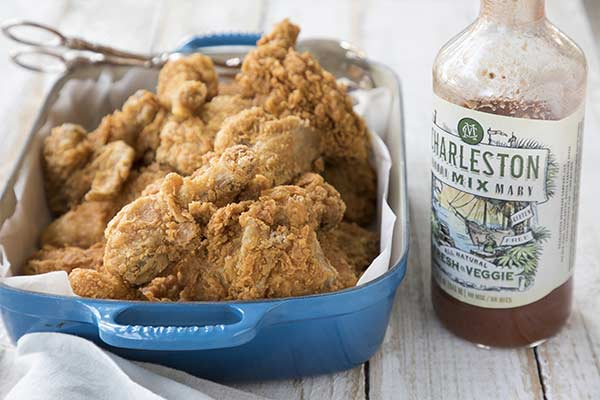 Image of fried chicken and bottle of Charleston Mix